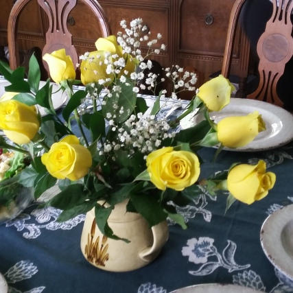 Yellow roses from Becca and Kathryn gracing our table.